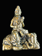 QuanYin brass deity statue, the Goddess of Compassion seated on an elephant