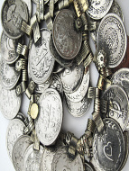closeup detail of 50 pc. hank of old afghani coin pendants