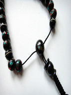 Traditional Nepalese prayer bead bracelet, showing sliding adjustable cord closure