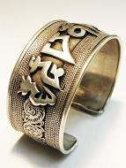 handcrafted silver-brass wide om cuff
