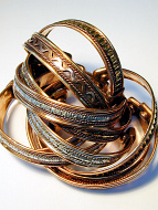 a typical assortment of ten narrow copper magnetic cuffs