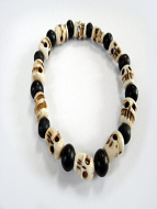 skull stretch bracelet with alternating bone skull and ebony beads