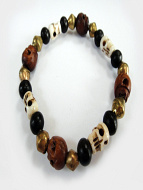 skull stretch bracelet featuring wood and bone skull beads with ebony and brass accents
