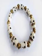 skull stretch bracelet with alternating bone skull and brass beads