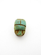 top view of small scarab bead, hole goes through from head to end