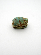 side view of tiny scarab bead