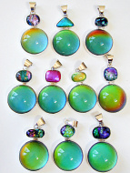 color-changing mirage cabochon set in sterling silver setting with dichroic glass