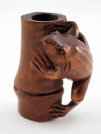 handcarved boxwood netsuke of frog on bamboo