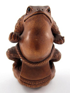 handcarved boxwood netsuke of sumo frog