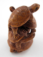 handcarved boxwood netsuke of turtles
