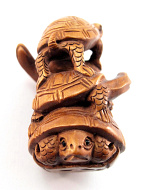 handcarved boxwood netsuke of turtles, symbols of longevity