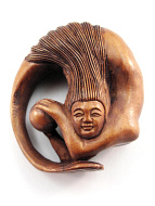 handcarved boxwood netsuke of a circling mermaid with pearl