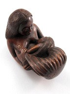 handcarved boxwood netsuke of a mermaid nursing her mer-baby