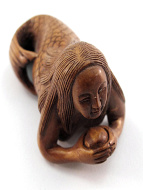 handcarved boxwood netsuke of mermaid holding a pearl