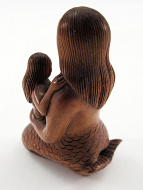 back view of handcarved boxwood netsuke of mermaid with child