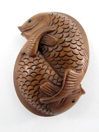 handcarved boxwood netsuke of two intertwining fish