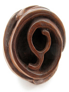 underside of handcarved boxwood netsuke of two fish spiraling