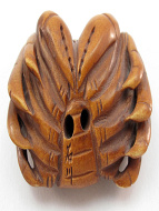 handcarved boxwood netsuke of crab showing hole through underside