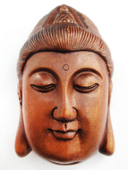 handcarved boxwood netsuke of Quan Yin face