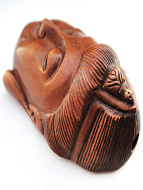 handcarved boxwood netsuke of the face of Quan Yin, the buddhist goddess of compassion