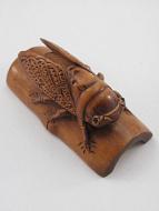 handcarved boxwood netsuke of cicada on bamboo