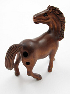 handcarved boxwood netsuke of horse in motion showing hole through right hind flank