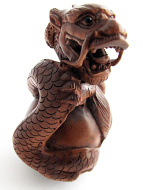handcarved boxwood netsuke of dragon with ball
