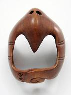 handcarved boxwood netsuke of bat showing hole on underside