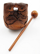 handcarved boxwood netsuke carving of two fish gong that comes with stick for gentle sound
