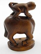 handcarved boxwood netsuke carving of monkey on horse