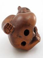 handcarved boxwood netsuke of bear showing hole on underside