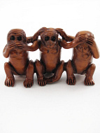 handcarved boxwood netsuke of three monkeys