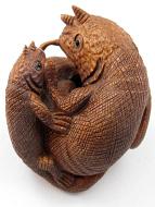 handcarved boxwood netsuke of chameleons
