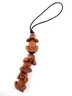 set of three handcarved boxwood ojime monkeys strung vertically together