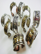 10pc assortment of Tri-Metal, Brass, Silver-Tone and Silver-Tone Filagree Om Rings