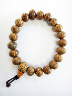 Pebble-shaped lotus seed beads, strung into a stretch bracelet with elastic cord