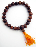 Sheesham wood beads strung into a stretch bracelet with elastic cord and tassel