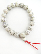 White Lotus Seed bracelet strung on stretch elastic cord