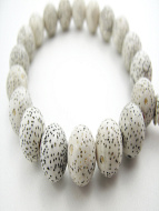 closeup of white lotus seed bracelet