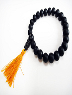 9mm Ebony wood beads with matte-finish, strung into a stretch bracelet with elastic cord and tassel