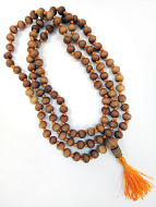 8mm knotted sandalwood mala coiled up