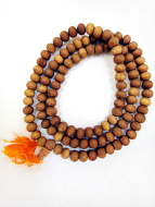 9mm sandalwood mala strand coiled up