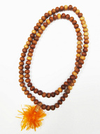 8.5mm sandalwood mala strand shown coiled up