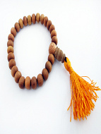 Naturally fragrant 8mm sandalwood beads, strung into a stretch bracelet with elastic cord and tassel