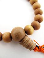 closeup of sandalwood mala prayer bead bracelet