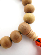 closeup of sandalwood mala prayer bead bracelet