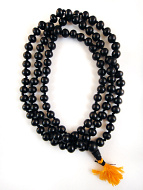 coiled strand of 10mm knotted ebony wood prayer beads
