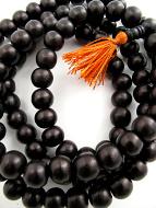 closeup of 12mm ebony wood mala prayer beads