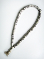 Prayer bead mala strand of 108 carved bone disc-shaped beads