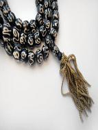 Prayer bead mala strand of 108 batik bone beads with the sanskrit symbol